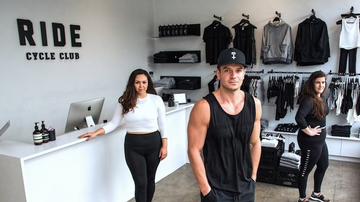 Serial entrepreneur and fashion industry scion JJ Wilson (centre) showing some of his clothing line along with staffer Diana Claxton (left) and assistant store manager Stephanie Stipancik. Wilson has launched his first clothing line independently of his family. Photo by Chung Chow.