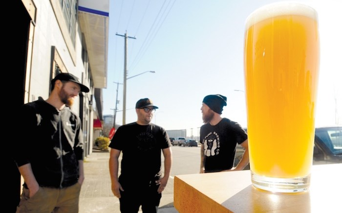 Matt Beere, Simon Koldyk and Darren Hollett, co-founders of Beere Brewing, Streetcar Brewing and House of Funk Brewing respectively, are all in support of a change in zoning bylaw to make it easier for breweries to open lounges. Photo by Mike Wakefield/North Shore News