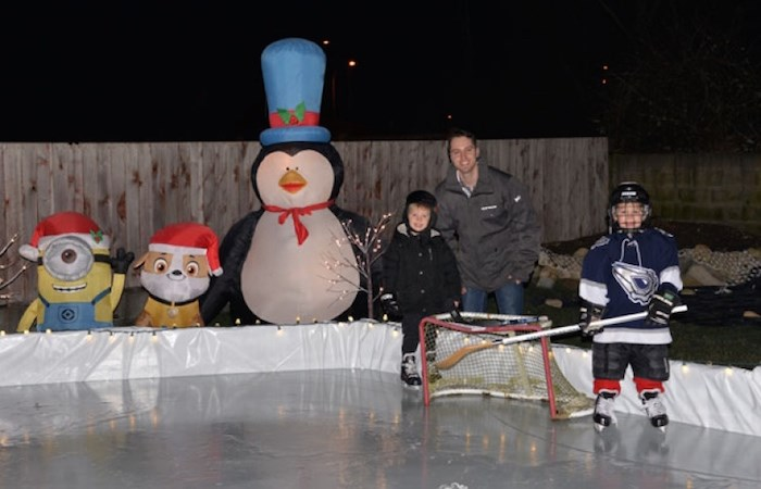 Ladner's Chris Dinter built a backyard rink for his boys Sam (right), 6, and Jack, 4. Photo courtesy Chris Dinter.