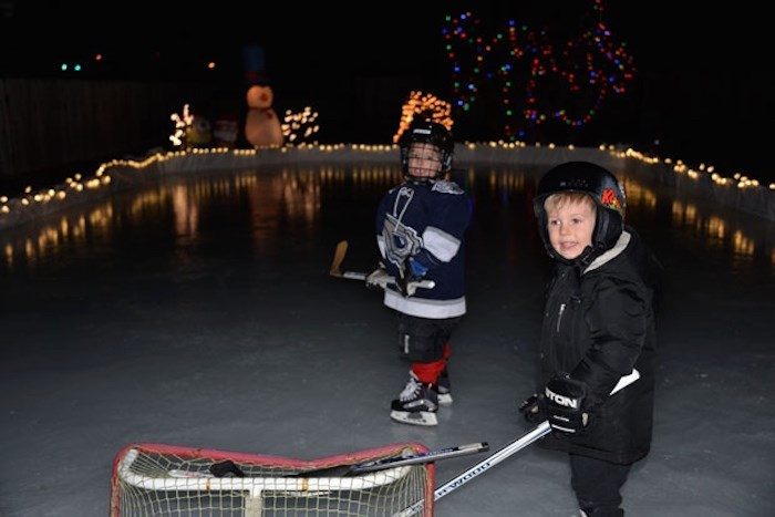 Sam and Jack Dinter went for a skate last night on their backyard rink. Photo courtesy Chris Dinter