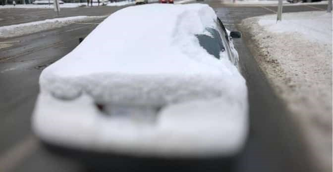 This driver was fined $109 for failing to clear the snow off their car. Photo: Richmond RCMP