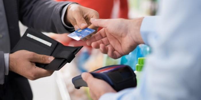 Customer making purchase in store/Shutterstock