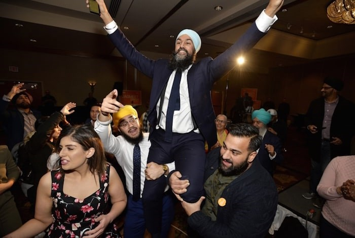Jagmeet Singh is carried around by the crowd at his victory party Monday night. Photo by Jennifer Gauthier.