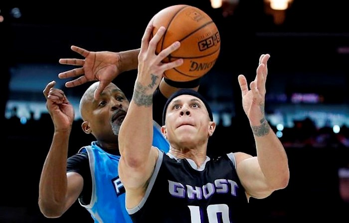 FILE - This is a July 16, 2017, file photo showing Ghost Ballers' Mike Bibby (10) attempting a shot as Power's Cuttino Mobley defends during the first half of a BIG3 Basketball League game in Philadelphia. Officials in a suburban Phoenix school district say police are investigating sexual abuse and harassment accusations lodged against former NBA player Mike Bibby, who coaches a school basketball team. (AP Photo/Rich Schultz, File)