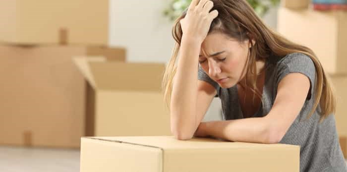 woman sad while moving / Shutterstock