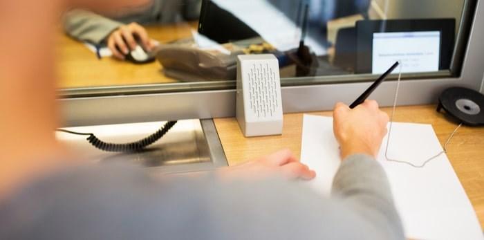 Bank teller window/Shutterstock