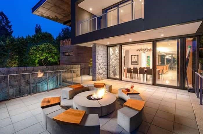 The front terrace, which leads off the dining room, has a great seating area with fire pit. Listing agent: Faith Wilson