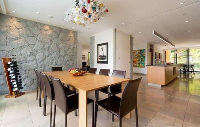 The dining room has one of a number of outdoor-to-indoor feature rock walls, and is open to the kitchen. Listing agent: Faith Wilson