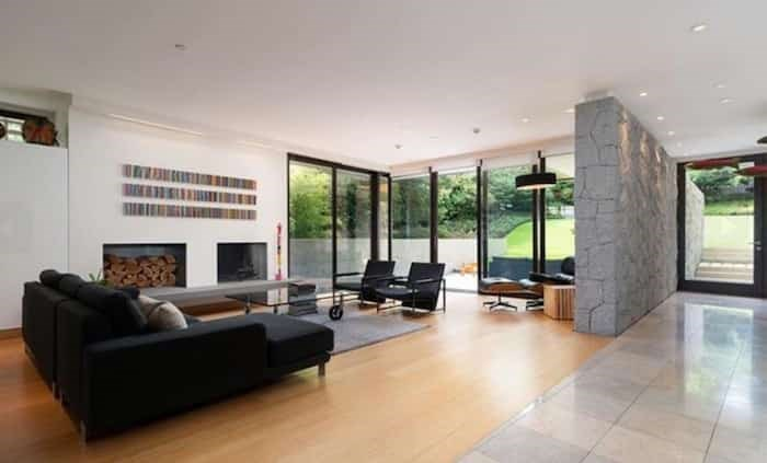 The large, open-concept living room leads out to the sloping back garden. Listing agent: Faith Wilson
