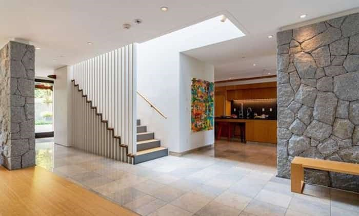 The Modernist touches continue with more interior rock walls and this linear staircase. Listing agent: Faith Wilson