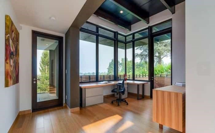 The high ceilings, panoramic views and terrace door make this home office a great place to work. Listing agent: Faith Wilson
