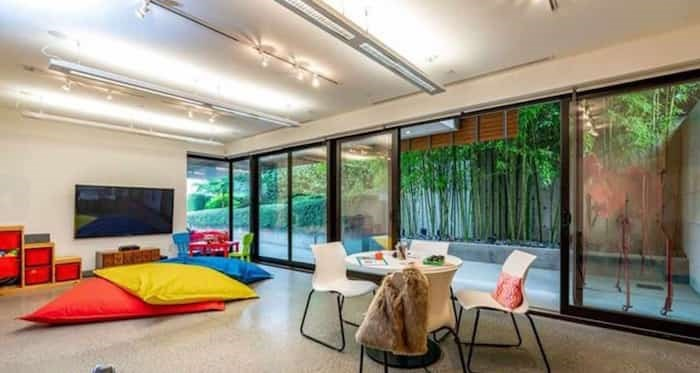 On the lower level is a comfortable family/play room that opens up to a side patio with a bamboo garden. Listing agent: Faith Wilson