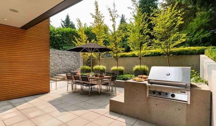 The patio at the back of the house has an awesome concrete built-in BBQ. Listing agent: Faith Wilson
