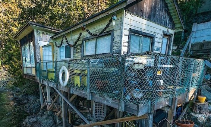 A photo of a home in Belcarra, B.C. is shown in this undated handout image. Seniors who own rustic cabins in a remote area near Vancouver say they face thousands of dollars in speculation taxes even though their properties are not suitable rental homes. THE CANADIAN PRESS/HO-John Lehmann