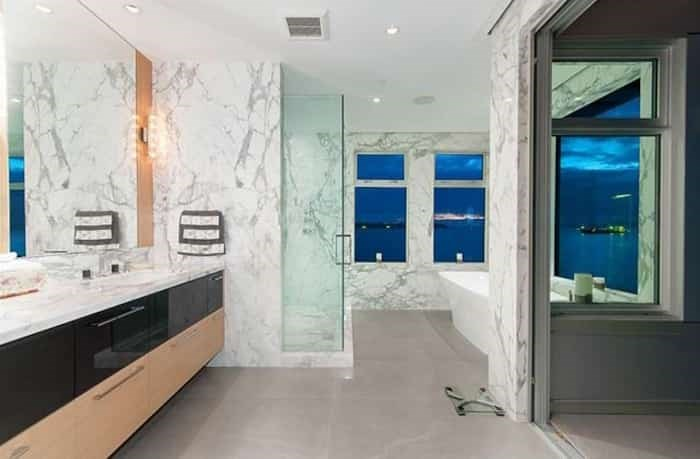 The incredible master bathroom has a tub with epic views, and a sliding door to the master suite's private upper deck. Listing agent: Nafiseh Samsam