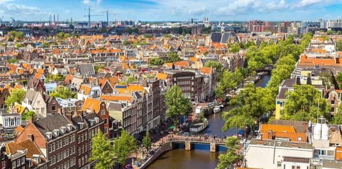 Panoramic aerial view of Amsterdam on a beautiful summer day, The Netherlands / Shutterstock