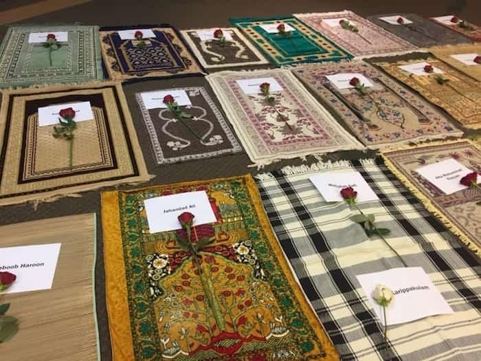 Empty prayer mats symbolizing each person who was killed were laid out at Az-Zahraa Sunday. Photo: Az-Zahraa