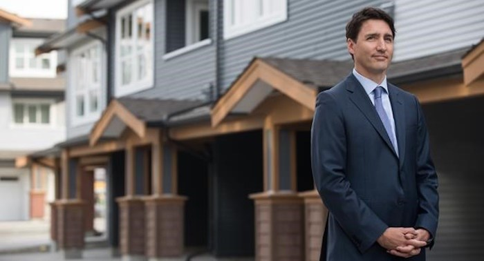 Prime Minister Justin Trudeau listens while being introduced before a post-budget housing announcement at a townhouse development in Maple Ridge, B.C., on Monday March 25, 2019. THE CANADIAN PRESS/Darryl Dyck