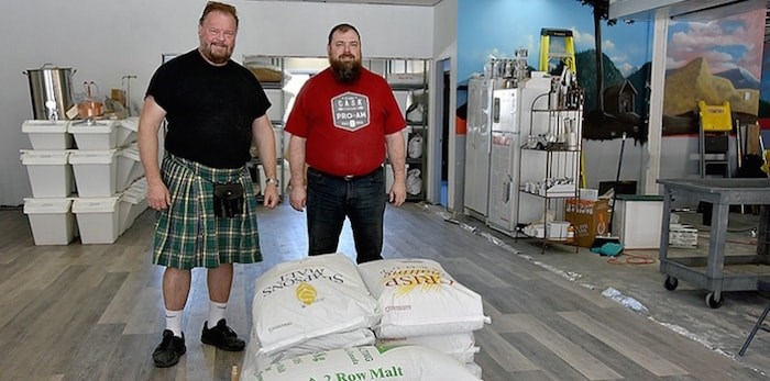 Fraser Mills Fermentation owners Tim Vandergrift (left) and Michael Druce, a Port Moody resident who owns Beyond the Grape. They and the other owners hope to open their craft brewery — the first in PoMo outside of Brewers Row, at 3044 St. Johns St. — in July. Photo by Janis Cleugh/Tri-City News