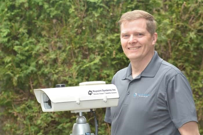 Delta's Nupoint Systems president Wayne Carlson with heir unique satellite camera that monitors remote environments. Photograph submitted.