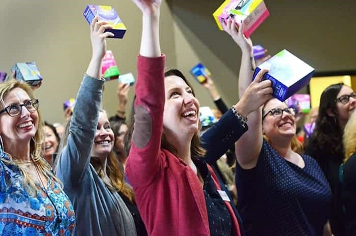 Participants in the United Way of the Lower Mainland's Tampon Tuesday campaign hold up donated tampons, pads and diva cups at a wrap-up event at the United Way's Burnaby headquarters in March 2018. Photograph by CORNELIA NAYLOR