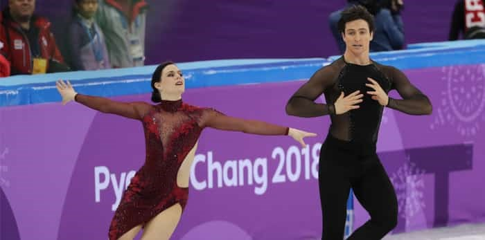 GANGNEUNG, SOUTH KOREA - FEBRUARY 12, 2018: Two time Olympic champions Tessa Virtue and Scott Moir of Canada perform in the Team Event Ice Dance Free Dance at the 2018 Winter Olympic Games / Shutterstock
