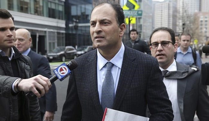 David Sidoo, of Vancouver, Canada, leaves following his federal court hearing Friday, March 15, 2019, in Boston. Sidoo faces an additional charge of conspiracy to commit money laundering for his alleged role in a college admissions scandal in the United States. THE CANADIAN PRESS/AP-The Boston Globe--Jonathan Wiggs