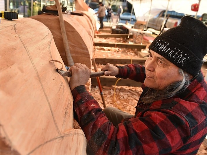 Squamish First Nation artist Xwalacktun is teaming up with his son James Harry and school-aged kids from across Vancouver to carve a 44-foot welcome post that will be erected outside the Vancouver School Board office. Photo by Dan Toulgoet.