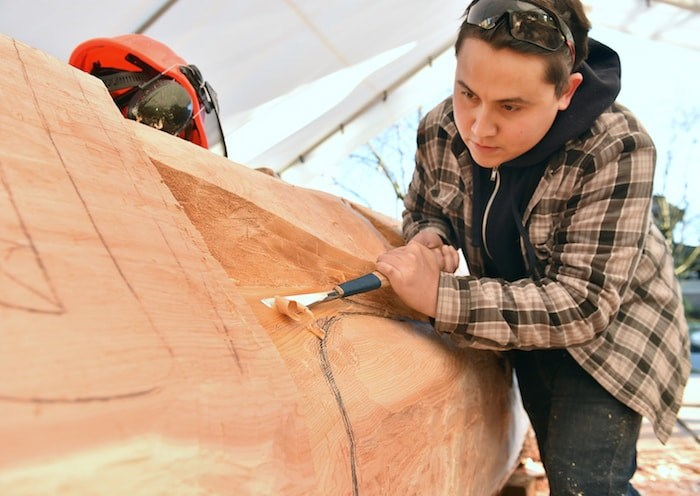 Squamish First Nation artist James Harry and his father Xwalacktun are teaming up with school-aged kids from across Vancouver to carve a 44-foot welcome post that will be erected outside the Vancouver School Board office in late June. Photo by Dan Toulgoet