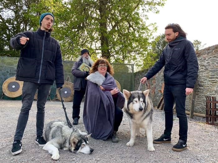 Writer Jennifer Bain gets to meet the Northern Inuit dogs that appeared as pups in Game of Thrones. Their owners, Caelan (left) and Ross (right) Mulhall, along with their dad William (back) all appeared as extras in the show.