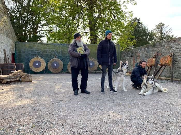 Meeting the Northern Inuit dogs that appear as pups in GoT. Their owners, Caelan (centre) and Ross (right) Mulhall, along with their dad William (left) all appear as extras in the show. Photo Jennifer Bain