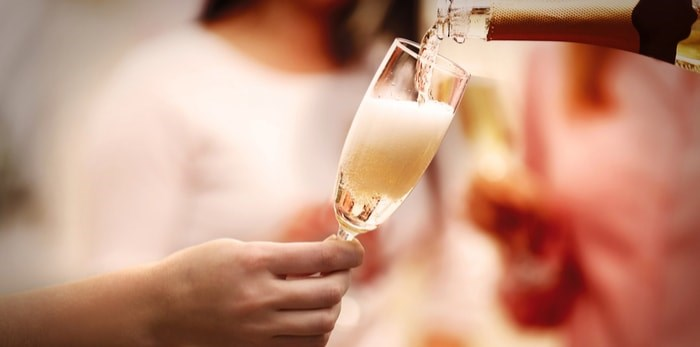 Pouring sparkling wine/Shutterstock