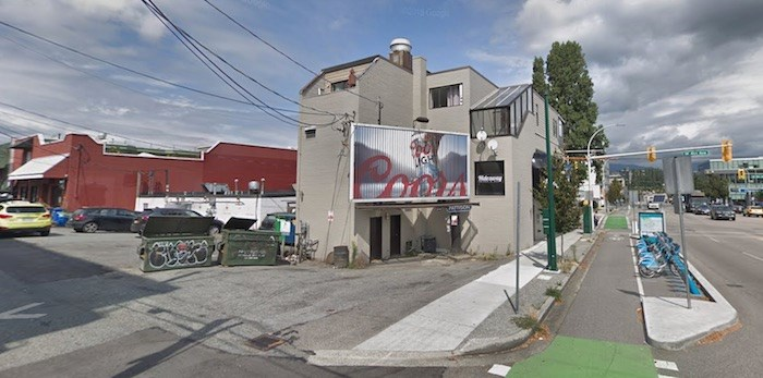 The victim was gunned down while he was in his parked vehicle under this billboard on Burrard at West Fourth, as seen in August 2018 on Google Street View.