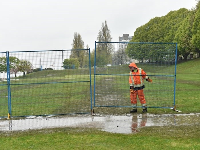 Crews put up fencing around the field at Sunset Beach Park April 22. Photo Dan Toulgoet