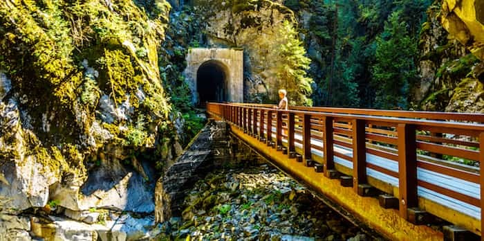 Bridges connecting the Othello Tunnels that were carved through the Coquihalla Canyon for the now abandoned Kettle Valley Railway at the town of Hope, British Columbia, Canada / Shutterstock