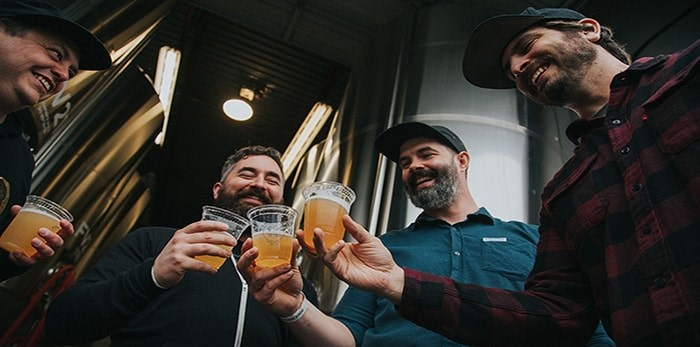 Collaborating brewers Ben Coli and Mitchell Warner (Dageraad Brewing), Brent Mills (Four Winds Brewing Co.), David Bowkett (Powell Brewery) at the 2019 VCBW Brew Day. Photo by Two Peas Photography.