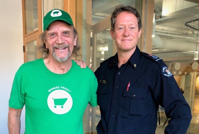 Michael Leland, left, was reunited with paramedic Will Riordon May 7 almost one year to the day that Riordon saved his life. Photo via Vancouver Courier.