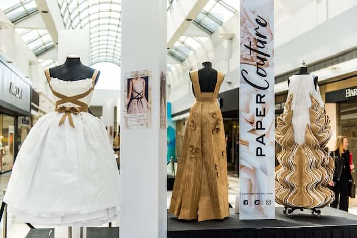 Some of the paper gowns on display at the Paper Couture exhibition at Oakridge Centre.
