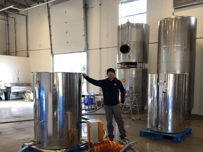 Frank Shang, owner of Richmond-based Fraser Sun Winery is getting ready to bottle 30,000 litres of blueberry wine. Photo: Submitted by Shang