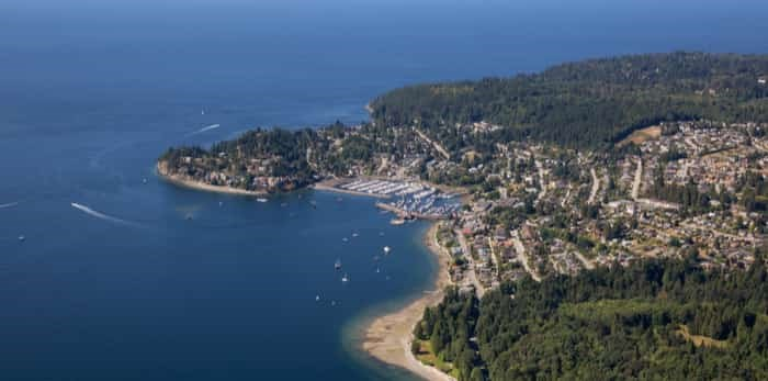 Aerial view of Gibsons during a sunny summer day. Located in Sunshine Coast, Northwest of Vancouver, B.C.