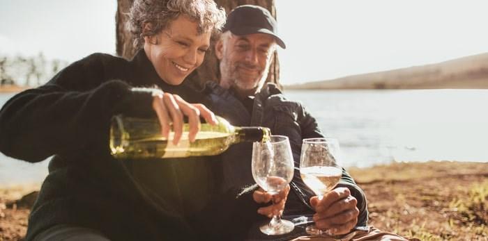 Couple drinking wine outdoors/Shutterstock