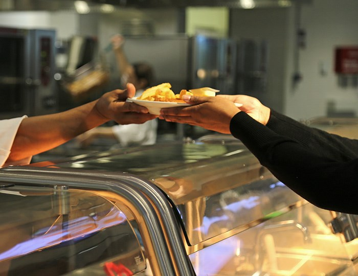 Ikea fish n' chips being handed to a customer in their cafeteria in Richmond. Photo Bob Kronbauer