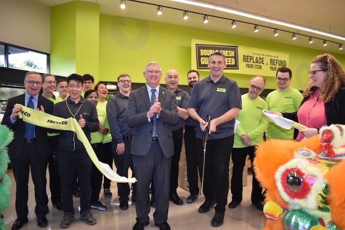 FreshCo Broadmoor celebrates its grand opening with a ribbon cutting ceremony attended by Richmond Coun. Bill McNulty. Photo by Alvin Chow.