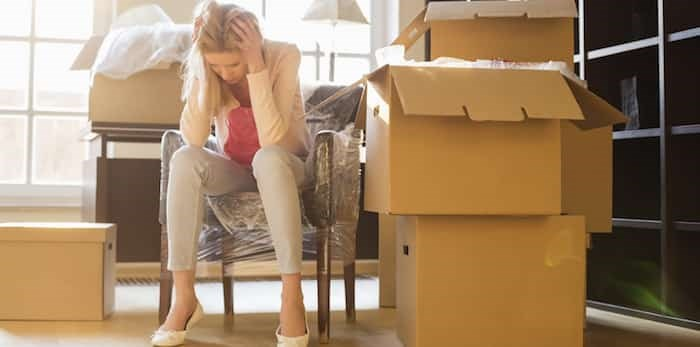 Woman frustrated while moving / Shutterstock