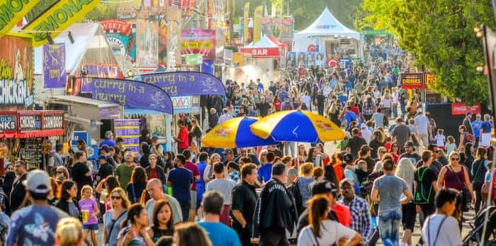 Thousands enjoy a beautiful day at the Fair at the Pacific National Exhibition / Shutterstock