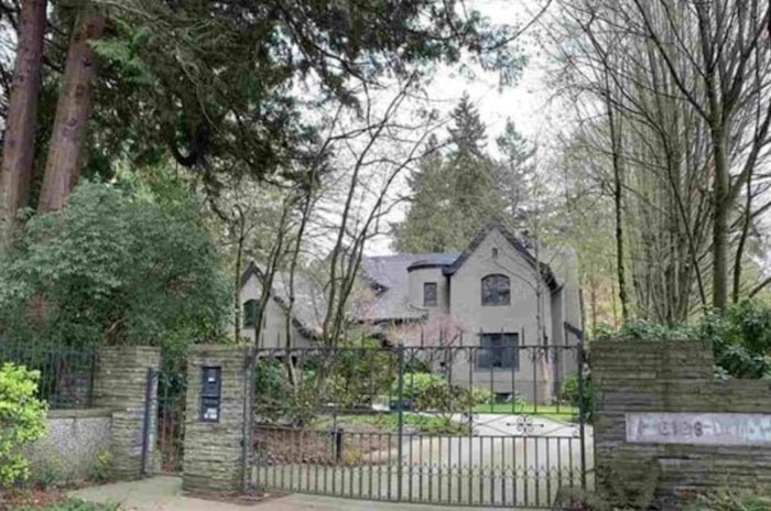 This house on Macdonald Street in Vancouver's toney Kerrisdale has sold for $9.8 million, far below its 2016 list price of $21.98 million. Image via MLS
