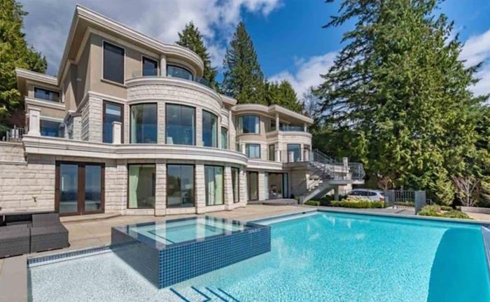 This modern mansion in West Vancouver's British Properties sold for $5.5 million, having been purchased by an investment group for $11.98 million. Image via MLS