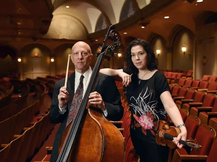 J. Warren Long has spent his entire adult life in the Vancouver Symphony Orchestra, while violinist Monica Pegis, who joined the ranks in January, is the VSO's newest member Photograph By Dan Toulget