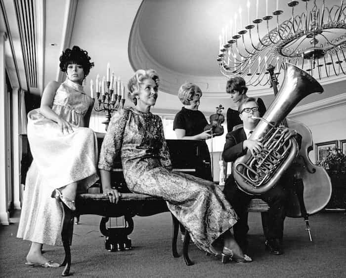 Models in 1967 with Wendy Hamper (violin), Layne Powell (bass) and Dennis Miller (tuba). - Photo by Vancouver Symphony Orchestra