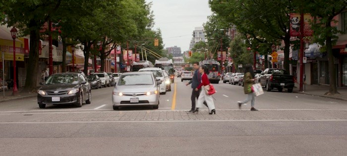 Park and Wong discuss life here in San Francisco while crossing Main Street in Chinatown in Vancouver. Screenshot/Netflix